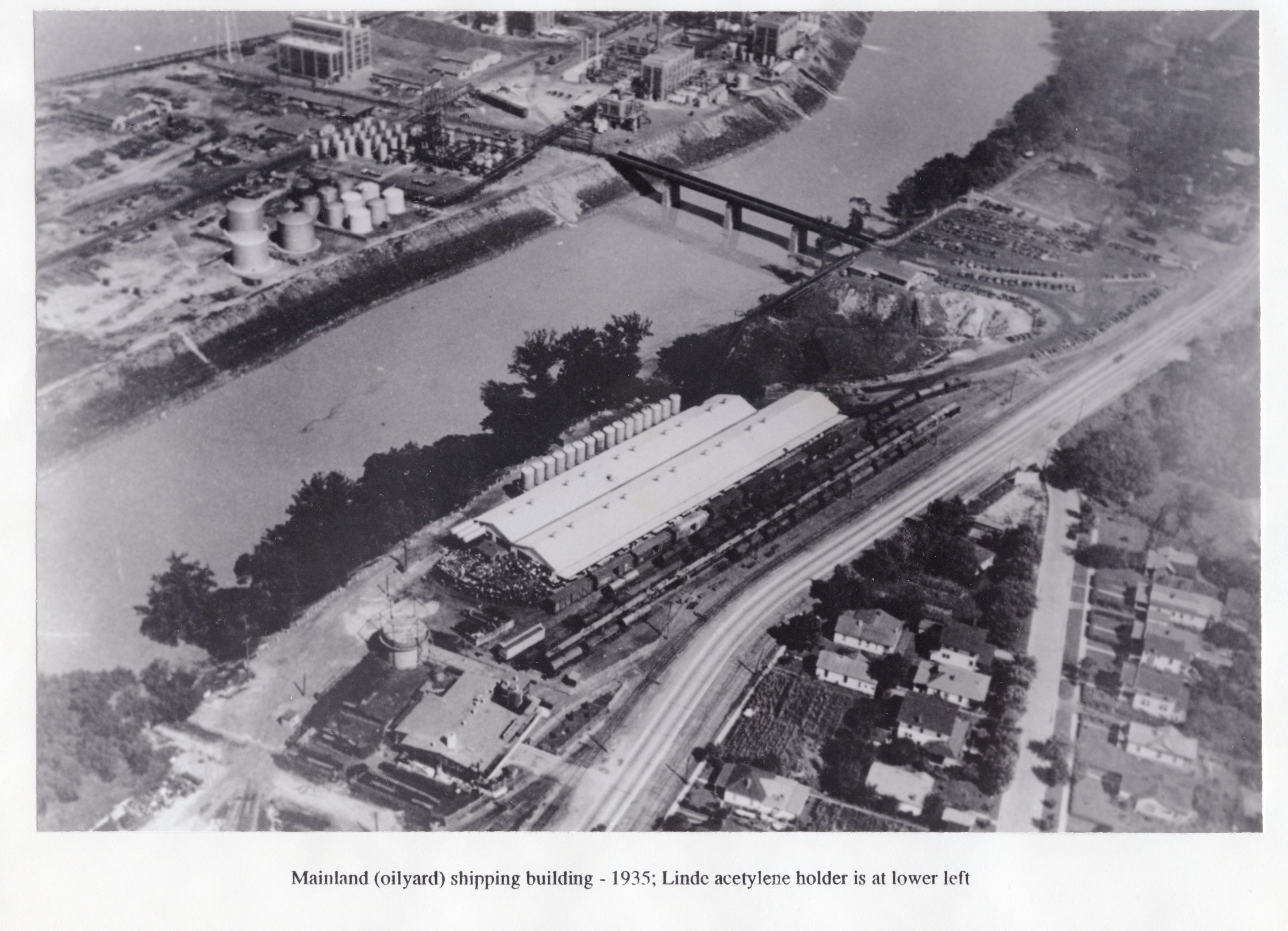 Carbide continues to grow: the Blaine Island bridge has been completed several years by the time of this 1935 photo, but the Carbide campus near where the bridge meets the mainland has not yet been developed (R. Hieronymus).