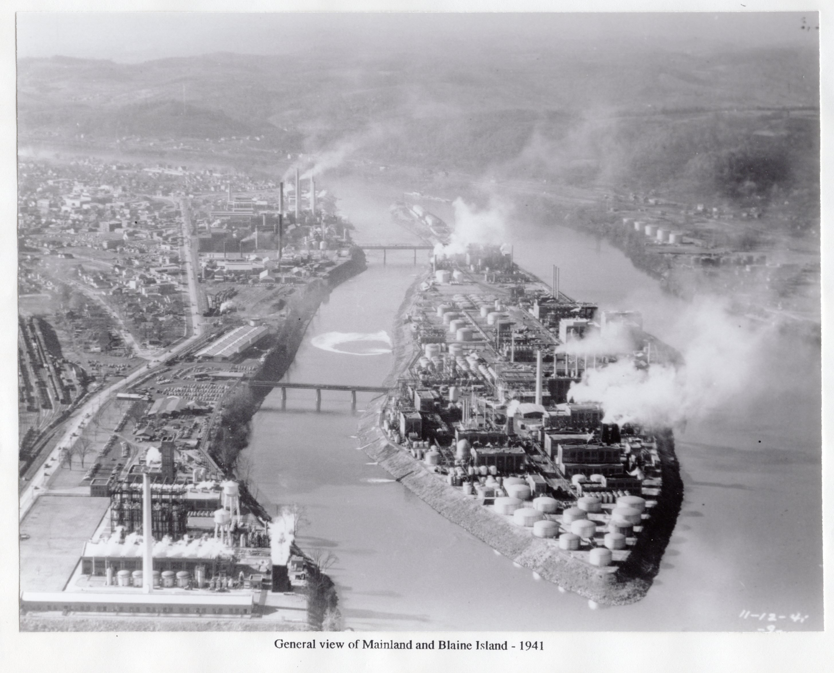 Blaine Island and the Carbide development near America's entry into WW2. Note the second bridge now necessary to support the Island's facilities. Pollution from the plant reached record levels during the war (R. Hieronymus).
