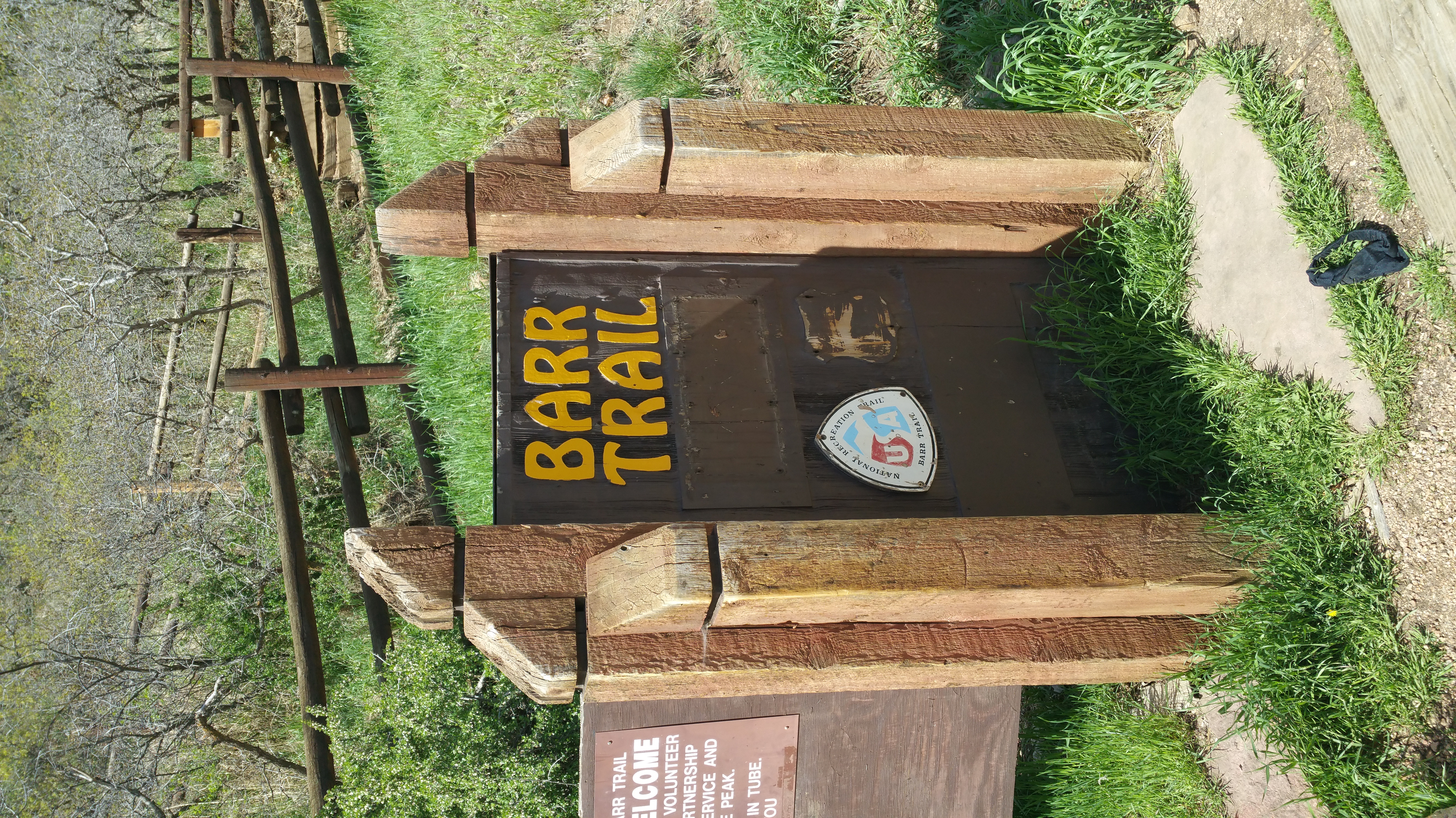 The trail head sign. Hikers can pay $5 for parking at the trail head or they can park down in town and take the shuttle for free.