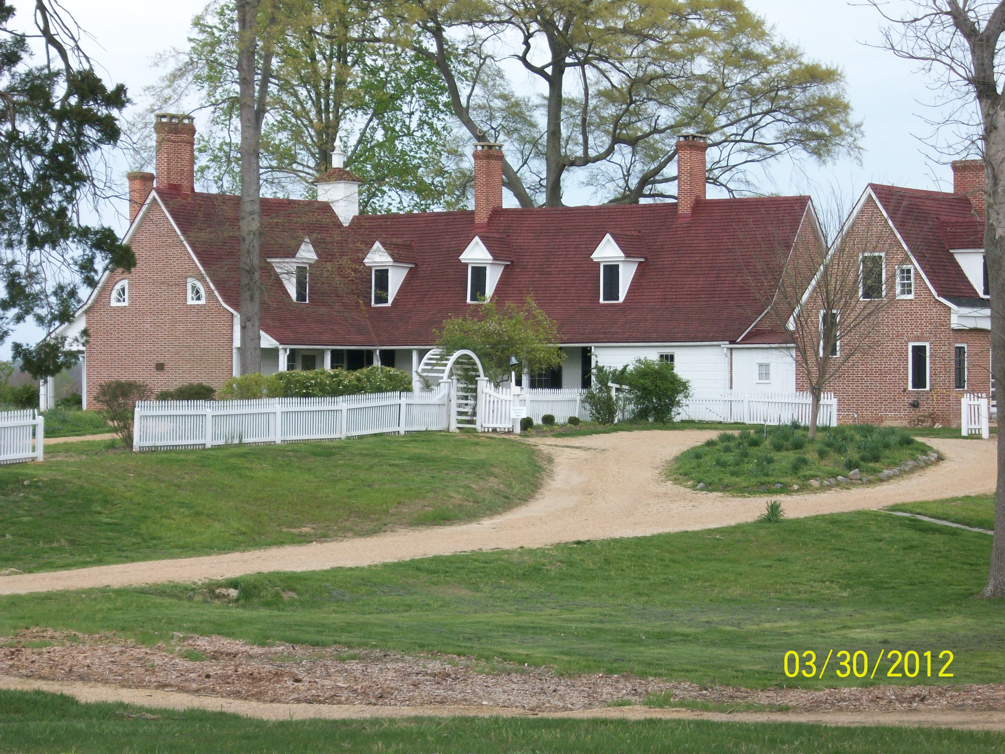 Sotterley's manor house dates back to the early 18th century. It has been altered by its owners over the centuries. The exteriors of the house visitors see today reflects the romanticized vision of Herbert Satterlee, the owner from 1910-1947. The view from the road side is shown here.