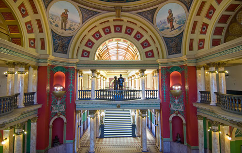 The area under the rotunda is colorful and features paintings and ornate decoration.