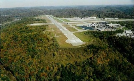 The landing strip at Yeager Airport formally Kanawha Airport. The grassy, forested hillside below the runway was the site crash and subsequent hunt for bails of marijuana.