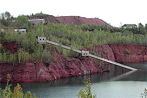 Mining operations ceased in 1978, and trees and other plants once again grow around the former open-pit mine.