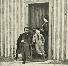 U.S. Grant, his wife Julia and son Jesse in front of his headquarters at City Point in 1864