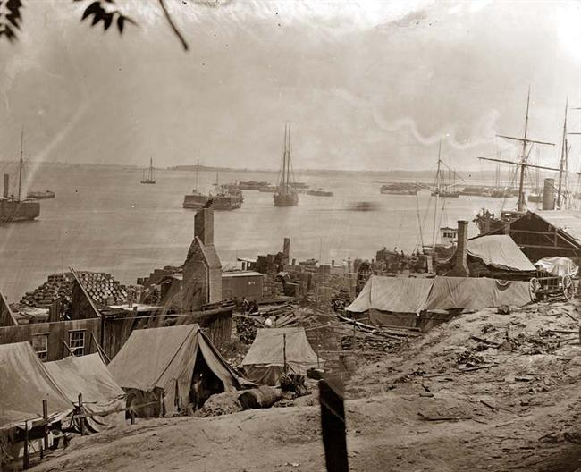 Union tents and supplies along the docks. Circa 1864-1865