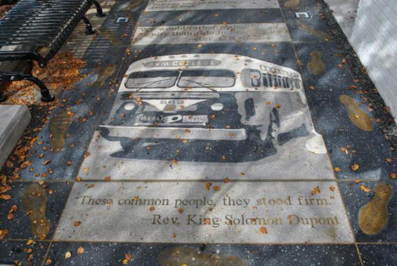 One of the sidewalk tiles that make up the sidewalk.