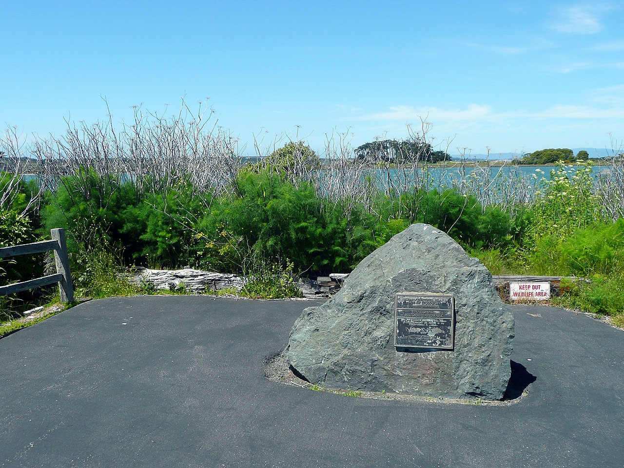 The historical marker is located at the end of the road on the west end of Woodley Island. Indian Island is visible in the background.