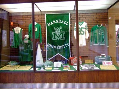 """We are Marshall"" Movie Memorabilia.  On November 14, 1970, 75 people including most of the Marshall University football team, cheerleaders and coaches and a number of supporters died in a plane crash."