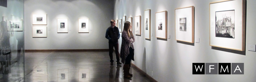 Visitors Exploring Art Exhibit