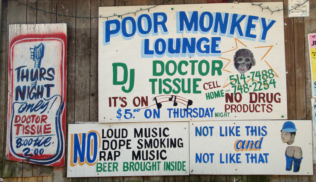 Signs on the exterior of Po Monkey's Lounge.