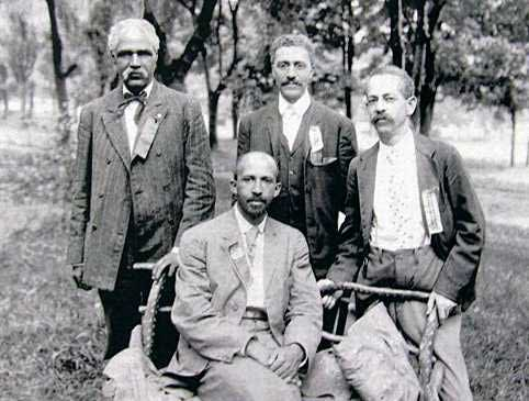 Niagara Movement leaders: W.E.B. Dubois (seated) and (left to right) J.R. Clifford, L.M. Hershaw and F.H.M. Murray. Photo taken at Harper's Ferry on April 17, 1906.