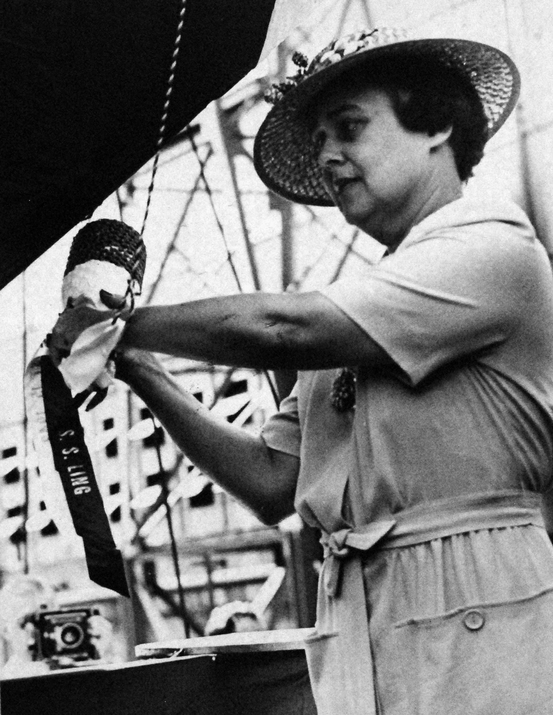 Mrs. E.J. Foy prepares to christen the ship. A Navy tradition dating back to the branch's earliest days, the sponsor of a ship, traditionally female, is thought to bring a ship good luck, and are permanent members of the crew.