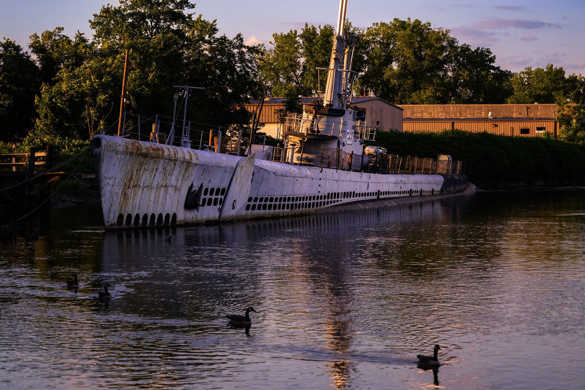 The Ling in its current condition, from a 2017 NY Times article. With the Hackensack River silted up from a nearby dam, the submarine is now grounded on the riverbottom. A dredging operation required to extract it is too expensive for present funds.