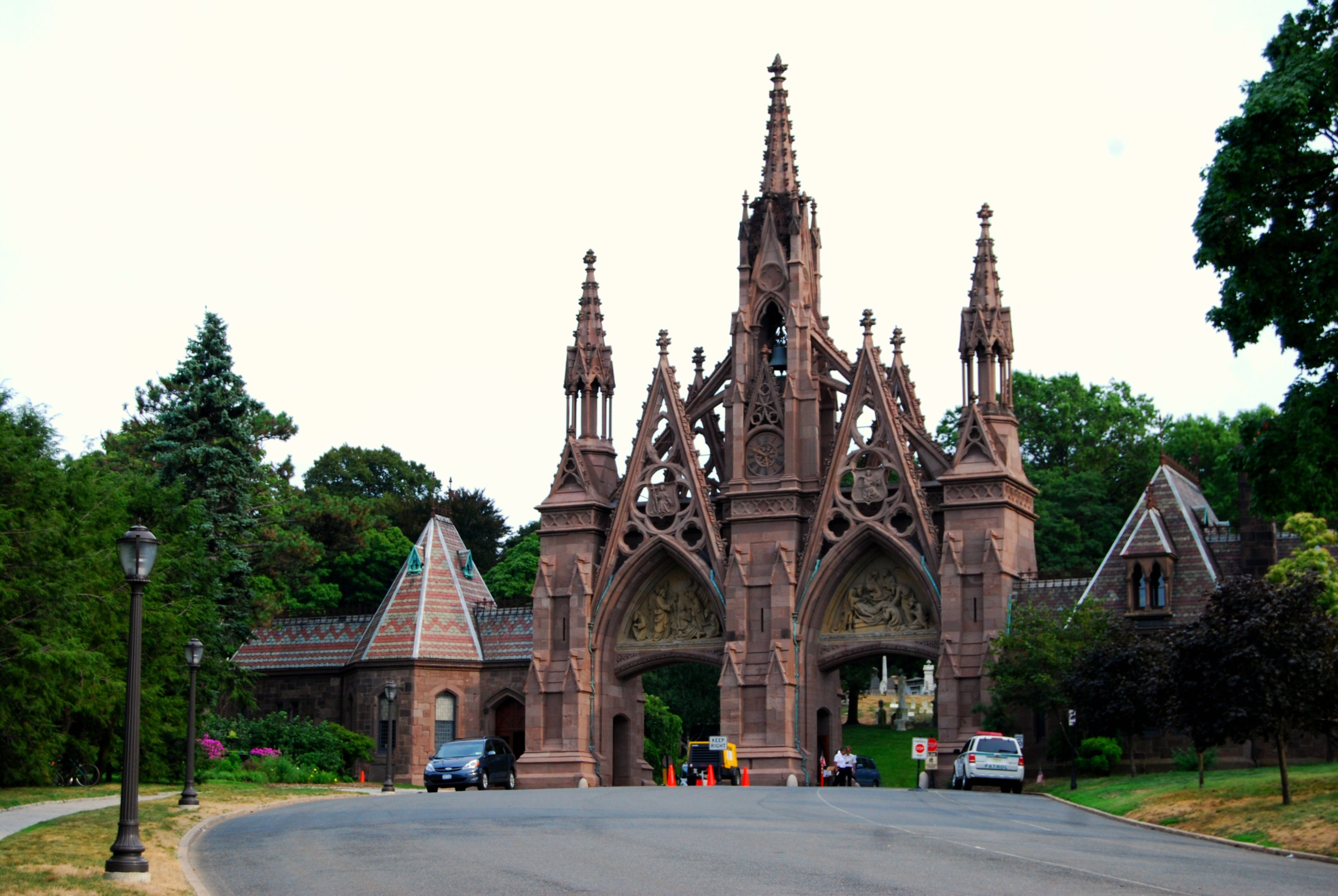 Visitors begin their journey by passing through the cemetery's Gothic main gate