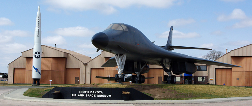 A jet aircfract is on display outside the entrance to The South Dakota Air and Space Museum