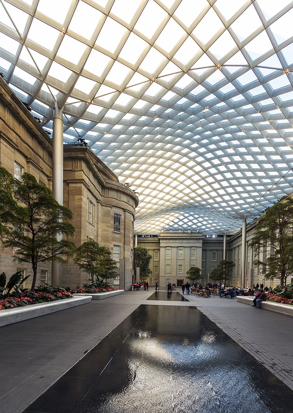 The Robert and Arlene Kogod Courtyard is a favorite spot for visitors both the National Portrait Gallery and Smithsonian American Art Museum. Photo by Acroterion, Wikimedia Commons.