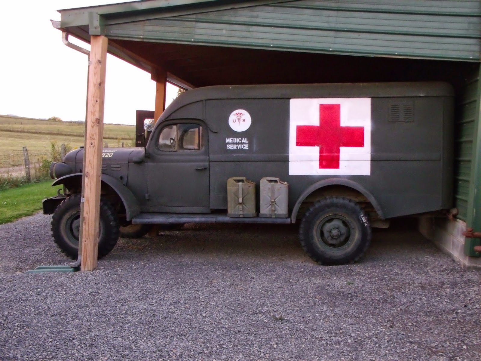 An old military ambulance on display outside.