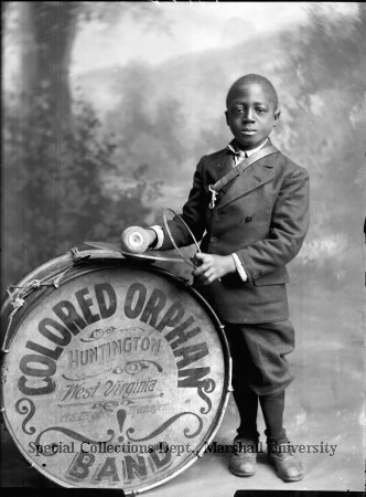 "African-American youth with drum. Part of the ""Colored Orphan Band Huntington, West Virginia, C. E. Mghee Manager"" in 1914. Courtesy of Marshall University's Special Collections."