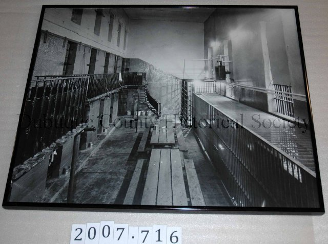 Print, Photographic, Black and white photograph featuring a view of the interior of the Old Dubuque County Jail. Courtesy of the National Mississippi River Museum.  Accession # 2007.716