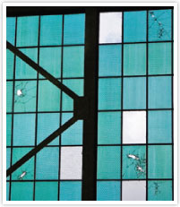 Windows in Hangar 79 with bullet holes from the attack