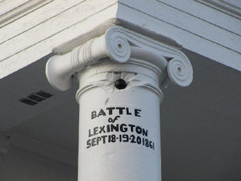 Battle damage can be seen as visitors take a tour of the battlefield and the Anderson House.