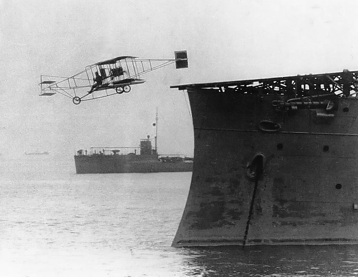 Eugene Ely's historic first flight from the deck of a ship. Library of Congress.