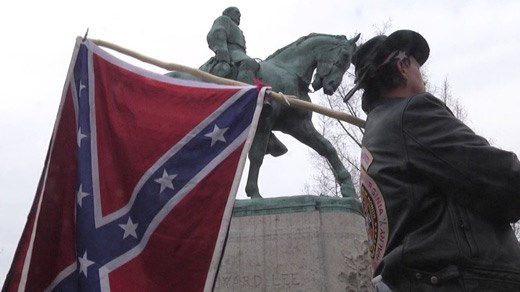 A counter-protester marches in defense of Confederate symbols during a March 2016 press conference discussing the fate of the Lee statue in Charlottesville.