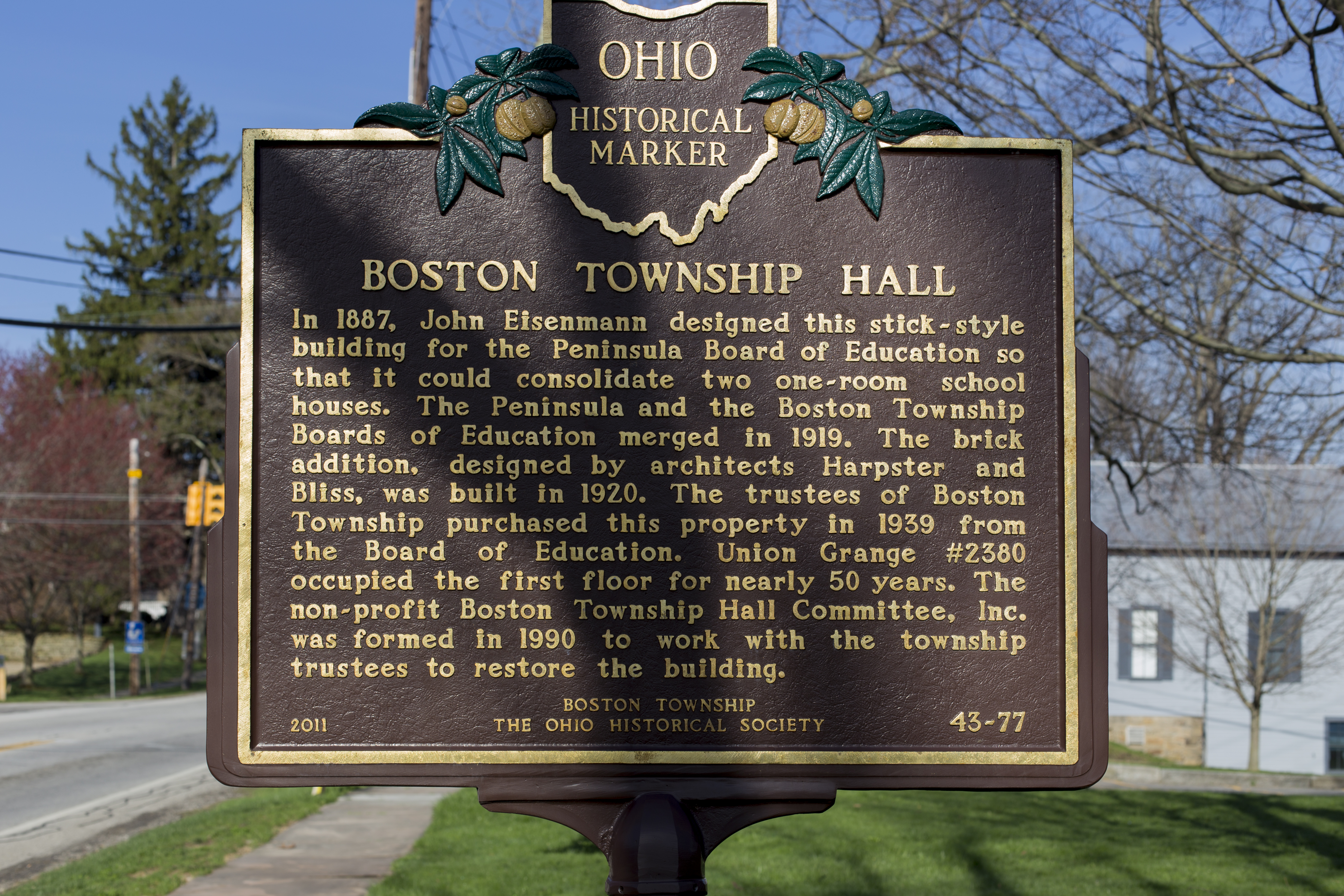 A historic plaque commemorating the Boston Township Hall and its designer.