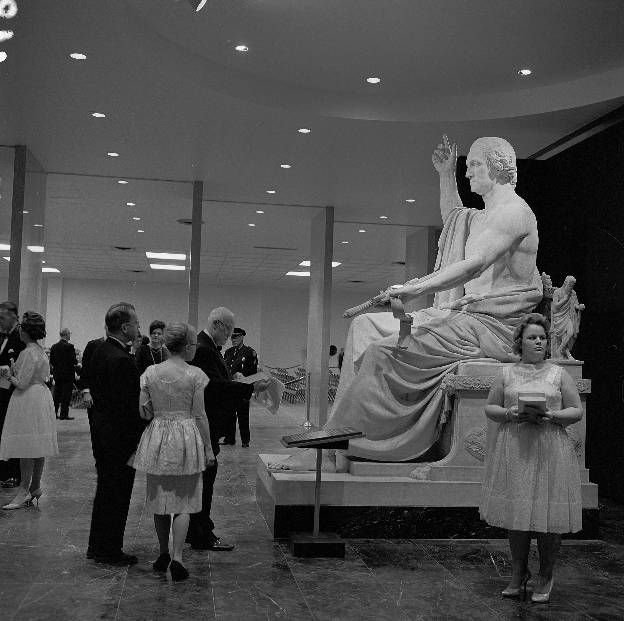 Visitors learn about Horatio Greenough's statue of George Washington at the museum dedication in 1964. Photo courtesy of the Smithsonian Institution Archives.