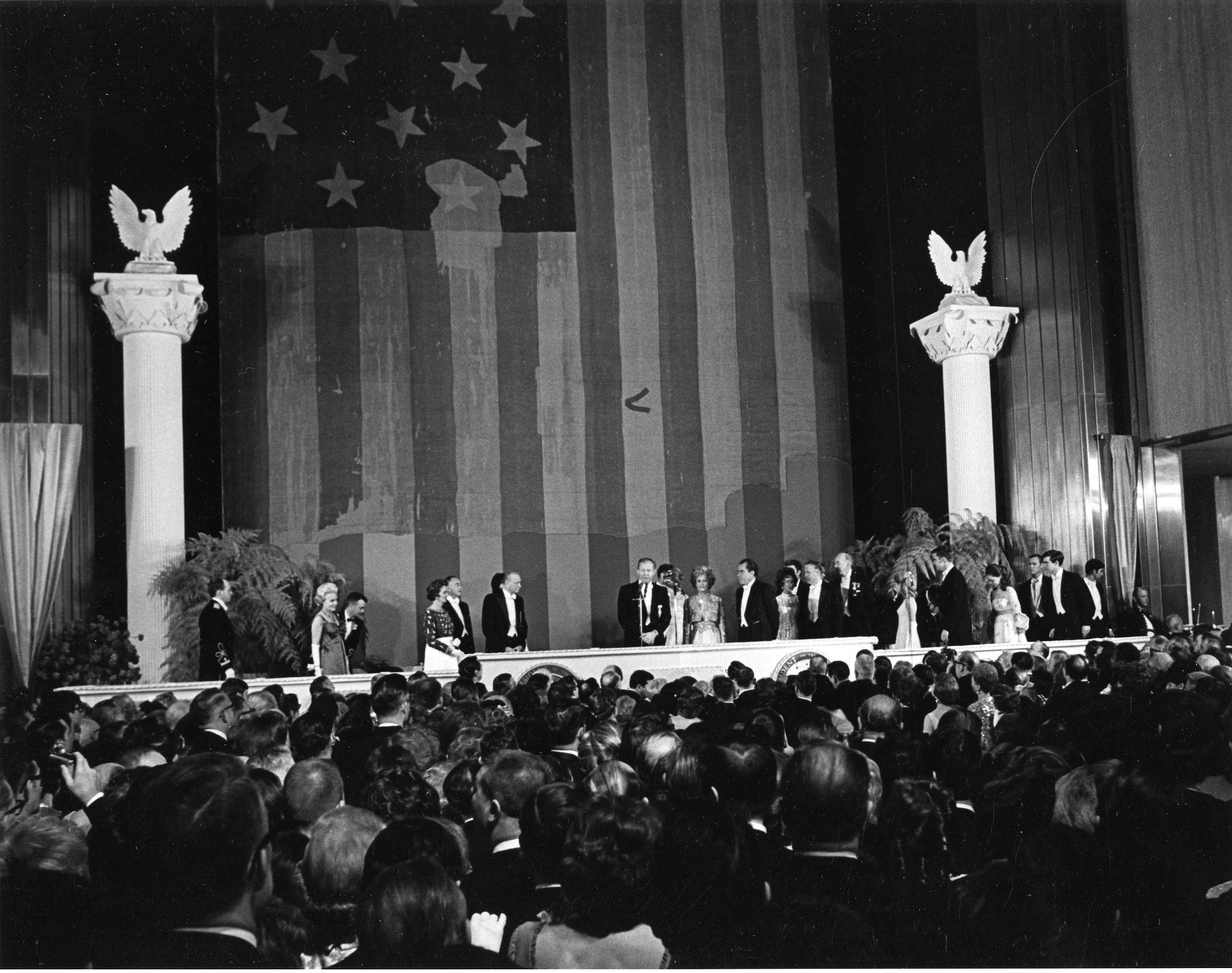 The Museum hosted President Richard Nixon's inaugural ball on January 20, 1969. Honored guests stand at the podium in front of the Star-Spangled Banner. Photo courtesy of the Smithsonian Institution Archives.