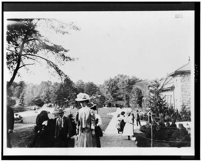 Guests walk along the main path at the National Zoo. Photo circa 1910s, courtesy of the Library of Congress.