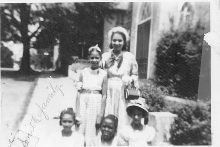 undated photo of family in front of St. Philips. Courtesy of JCBHPS