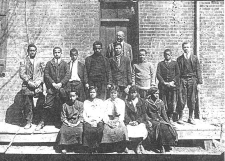 late 1800s photo of Philip Jackson (one of the namesakes of Page-Jackson HS) with his students at the Harewood school after leaving its original location in the Dixon home.