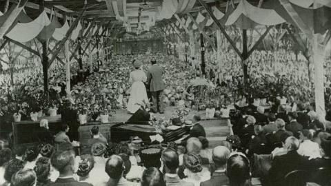Billy Sunday speaking at a large revival. Tabernacles, or tent-like structures, were built just to house the thousands of people who would travel to hear him talk.