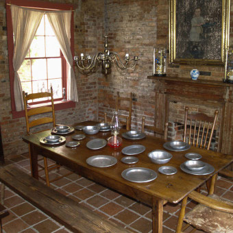 Above the brick kitchen, seen in the picture, were rooms for the enslaved individuals who worked in the house.