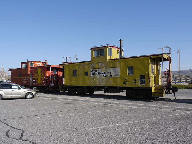 Two of the several train cars located at the museum