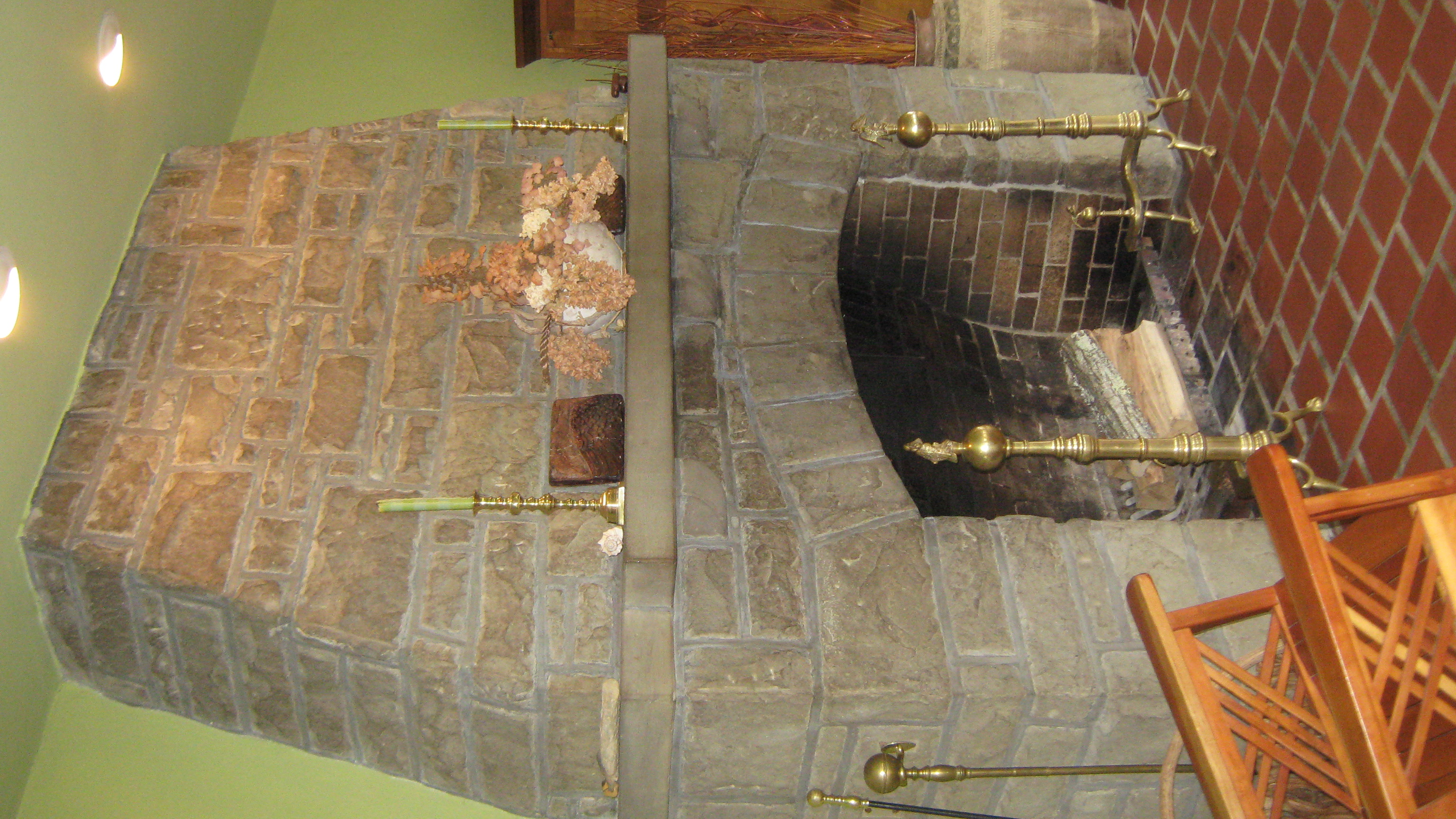 The home's stone fireplace was added as part of the Sidney Day additions in 1923.