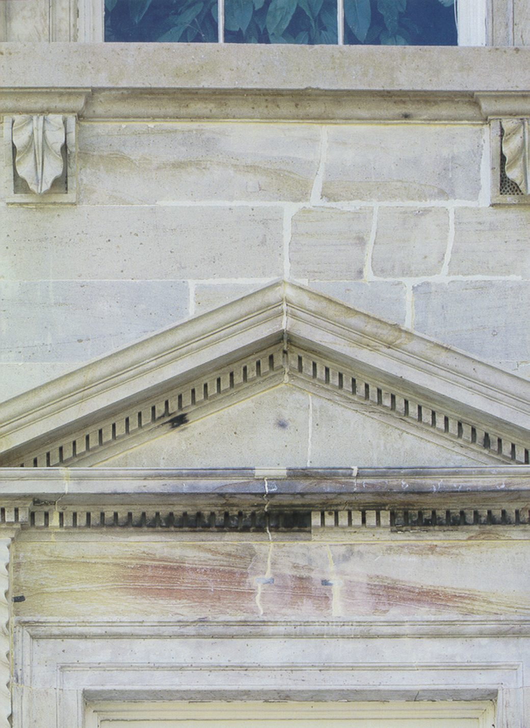 During building renovations in the 1990s, dozens of layers of paint were removed. This photograph of a section where the paint was removed shows the burn marks from 1814.