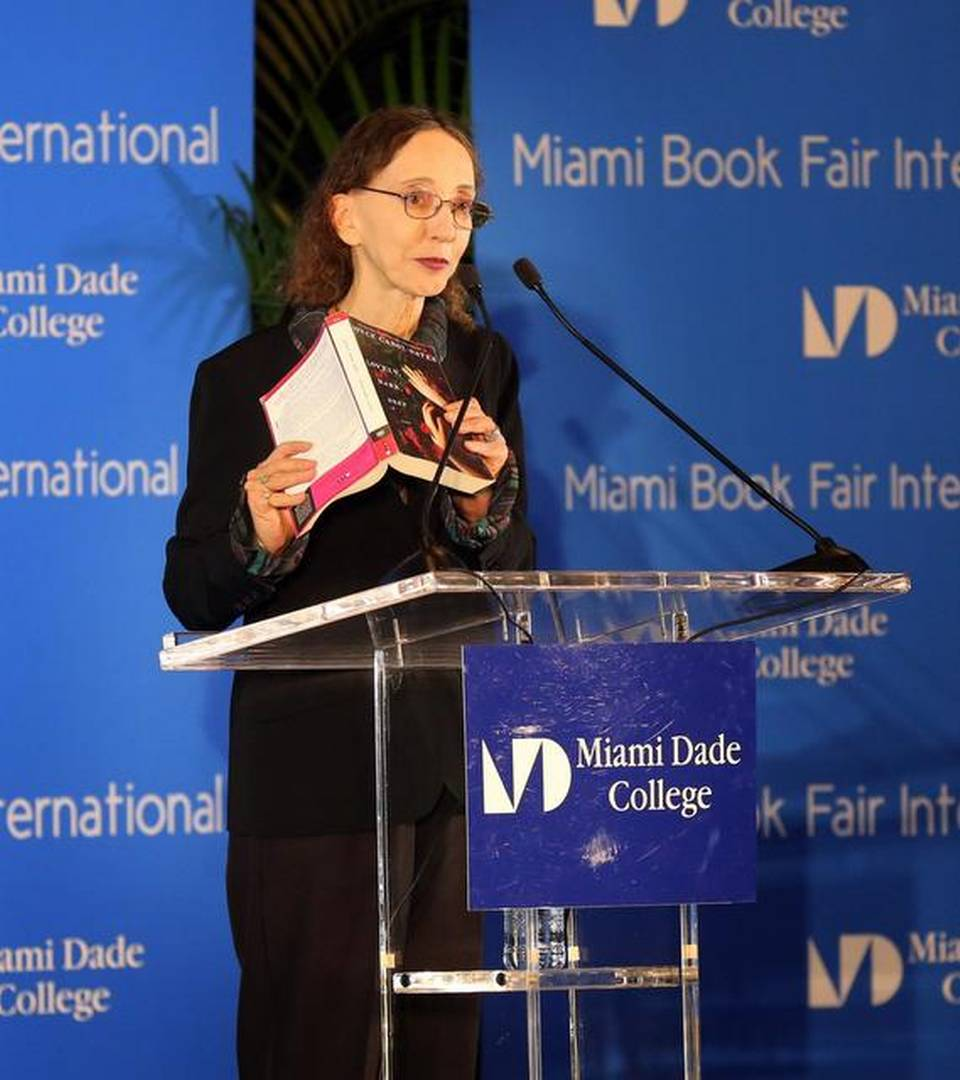 Author Joyce Carol Oates reads from her book, 'Lovely, Dark, Deep' at the Miami International Book Fair.