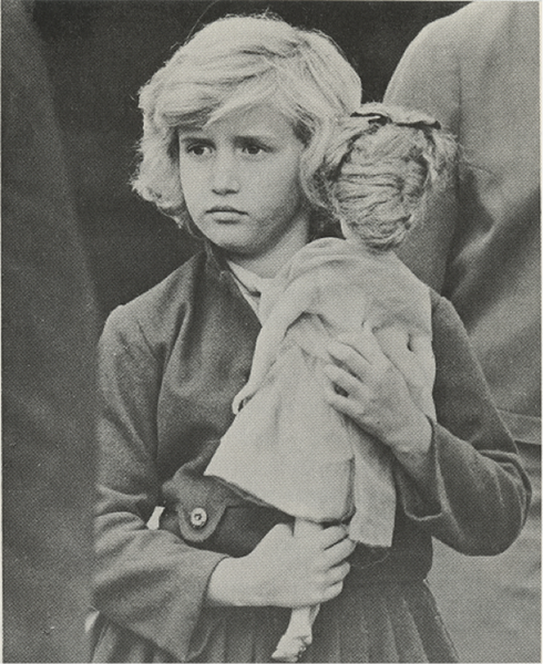 A young girl holds her doll as she arrives in the United States with the Operation Pedro Pan Program, circa 1960-1962.