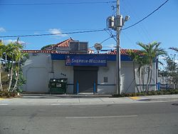 Front view of the historic building that was home to a gas station and is now home to a body shop.