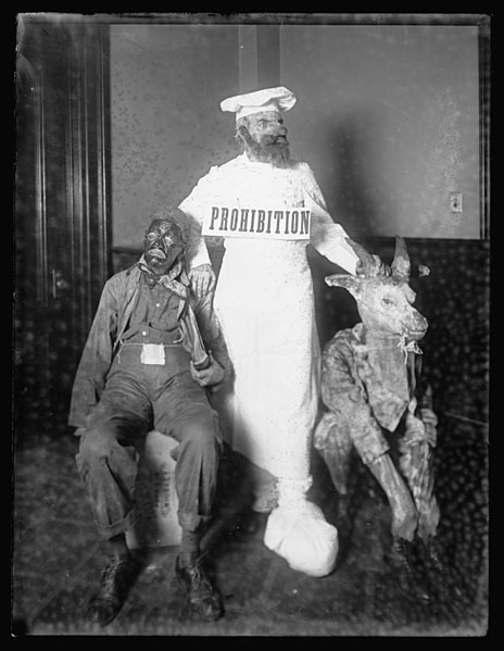 This is an example of the racist push for prohibition. Prohibition can be seen stopping the black people from drinking. Prohibition is also holding back an animal which is a depiction of the poor whites who drank. The idea was that keeping these people from drinking would lead to a more harmonious society.