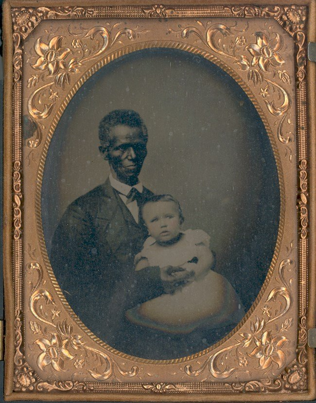 Charles Syphax was a slave transferred from Mount Vernon to Arlington by the Custis family. Many descendants of Syphax and his wife, Maria Carter Syphax, were influential leaders in Arlington. National Park Service.