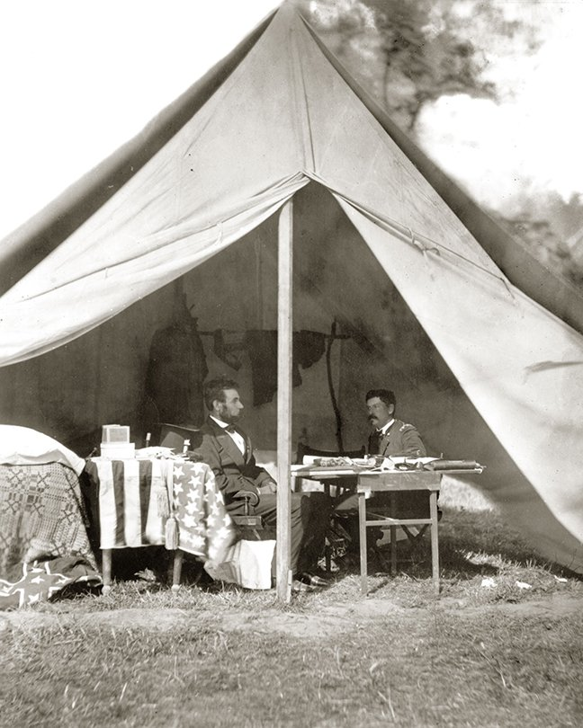 President Lincoln visited General McClellan at his camp headquarters on October 4, 1862. A close look at this photograph shows both the American flag and captured Confederate battle flag on the left.
