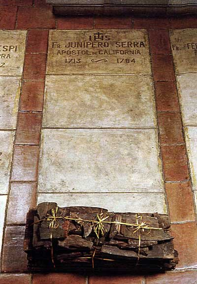 The grave of Padre Serra under the floor of the sanctuary inside the basilica. Buried alongside him are his successor, Padre Fermin Lasuen, and two other Franciscan friars from the era.