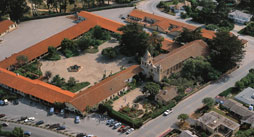 "Bird's eye view of mission. The ""quadrangle"" to let of the basilica had to be rebuilt through painstaking restoration--the original was destroyed in the 1800s."