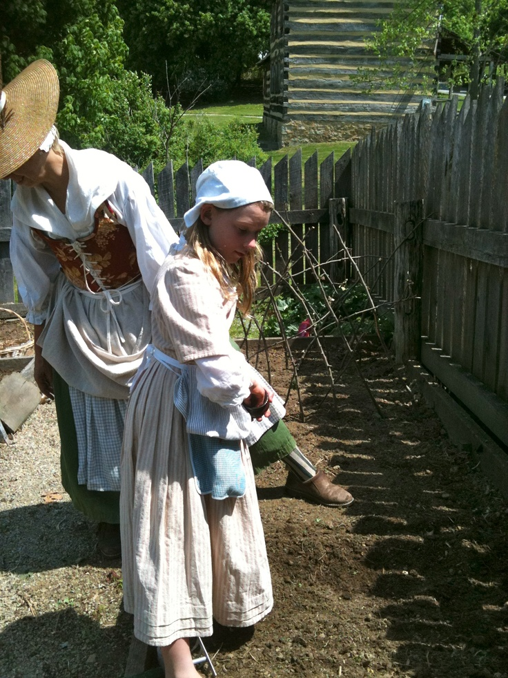Re-enactors depicting 18th century dress and daily life.