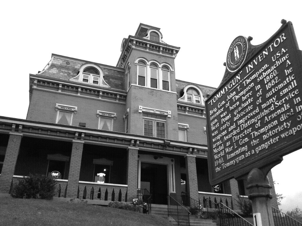 """Exterior of the Thompson House with the """"Tommygun"""" Inventor historic marker."""