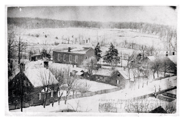 1860s wintertime shot of Old Salem. Log church on far right