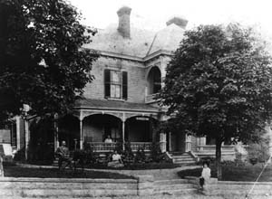 Old Kentucky Home/Thomas Wolfe Memorial in 1906. Thomas Wolfe as a child is siting on stone wall